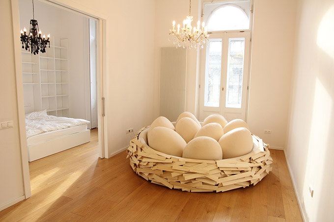 Giant-Birdsnest-Humans-Filled-With-Giant-Egg-2